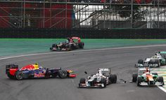 (L-R) Mark Webber of Australia and Red Bull Racing, Kamui Kobayashi of Japan and Sauber F1 and Paul di Resta of Great Britain and Force India get involved in an incident at turn one during the Brazilian Formula One Grand Prix