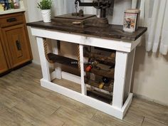 Here you can see another idea to copy if you want to create a uniquely designed entryway table because it contains the place to fit the bottles that are looking nice and anything for the decoration can be placed over the surface of the table.