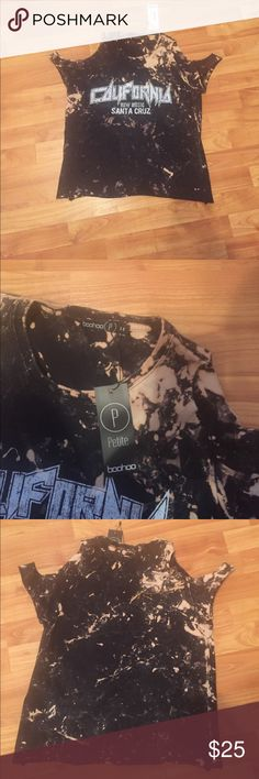 Boohoo online boutique band tee. Boohoo band tee, black with acid wash design. Distressed off the shoulder sleeves. Never been worn, just bought today. Boohoo Tops Tees - Short Sleeve