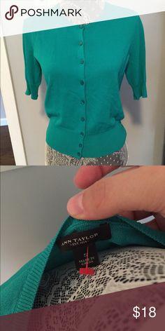 Short sleeve cardigan by Ann Taylor Teal cardigan with short sleeves by Ann Taylor. Perfect for work Ann Taylor Tops