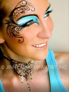 Sky blue eye shadow with artistic black scroll work accented with jewels by Jinny Makeup Artist Inc.