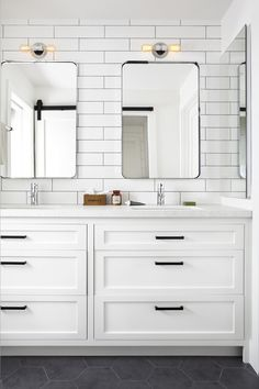 Tips To Create A Modern Farmhouse Fresh all-white bathroom with subway tiled walls, recessed panel Shaker cabinets and slate tile flooring.Fresh all-white bathroom with subway tiled walls, recessed panel Shaker cabinets and slate tile flooring. Craftsman Farmhouse, Modern Farmhouse Design, Modern Farmhouse Bathroom, Modern Rustic, Rustic Farmhouse, Urban Farmhouse, Modern Coastal, Farmhouse Style, Farmhouse Ideas