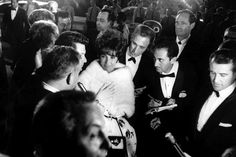 Elizabeth Taylor walks through a crowd of admirers at the Oscars in 1961 — the year she won her first Academy Award, for her role in BUtterfield 8