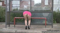 Sexy tights upskirt. Woman in arse revealing mini skirt, nude colour pantyhose with black panty line and heels bends over in pubic street.