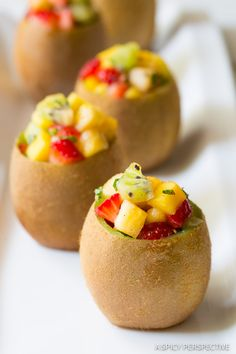Tropical Fruit Salad with Vanilla Bean served in fresh Kiwi Cups! This simple fruit salad recipe is loaded with kiwi, mango, pineapple and strawberries,