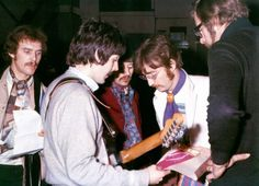 Paul, Ringo and John with Neil Aspinall and Mal Evans