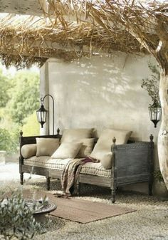 Old daybed repurposed to outdoor furniture :-) love it with all the pillows!!!!