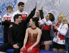 Tessa Virtue and Scott Moir of Canada, foreground, wait in the results area after competing in the team free ice dance figure skating compet...