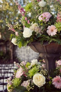 Outdoor water fountain made Floral arrangements for wedding ! Gorgeous. !