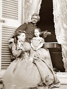 Gen. Edward O.C. Ord, wife and child at the residence of Jefferson Davis. In the doorway is the table on which the surrender of General Robert E. Lee was signed. Photo taken in 1865.