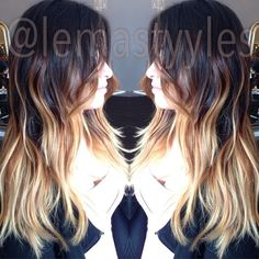 Kept her dark roots, and lightened up her ends while balayaging some brunette to blend