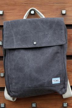 Gear up in a Slate Washed Canvas Trekker Backpack with a 13 inch laptop pocket for work or school.