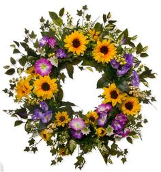SW166 Our in-house designer only uses the finest silk floral available including yellow sunflowers, purple hollyhocks, purple petunias, white status, fern, and greenery. $124