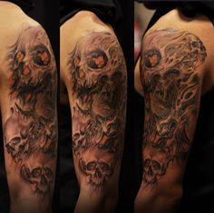 Half sleeve black and grey-colour Hannya Mask and Skulls tattoo