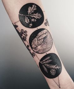 2 black circles each forearm; right is daisy and wishbone, left is rose and pinky promise