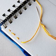 A couple of super easy ways to add pockets to art journals and notebooks
