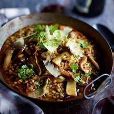Barley Risotto with Garlicky Mushrooms | Chef Naomi Pomeroy uses barley to make her hearty version of risotto, packed with sautéed oyster mushrooms. The dish is substantial enough to be a main course; to make it vegetarian, substitute good vegetable stock for the beef broth.