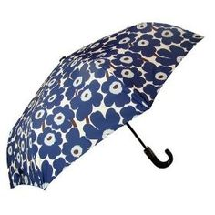 Make a rainy day fun with this playful umbrella by Marimekko. Covered with bright blue flowers, this umbrella will add a bit of color to a dreary day.