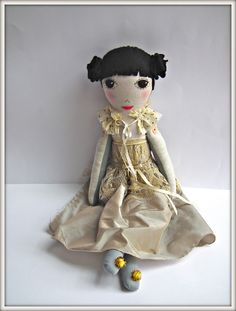 cloth doll..like the dotted lines around the eyes and the hair.