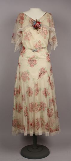 Date Made: 1928-1929  Description:  Dress; sheer ivory net printed with magenta roses, overdress (A) with matching belt (B).