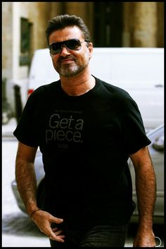 George Michael wearing his Texas charity t-shirt...Goss-Michael foundation.