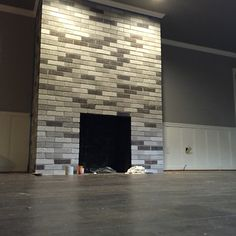 My after fireplace project. Painted each brick with leftover wall/ceiling paint…