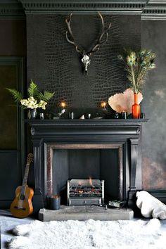 Dark black walls croc wallpaper fireplace