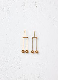 Dot Mobile Earrings in Brass - セリーヌについて