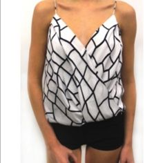 Black and White Jay Godfrey Blouse Gorgeous blouse whether paired with a skirt, pants or a pants suit! Jay Godfrey Tops Blouses
