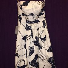 Strapless Hawaiian AnneTaylor Navy Floral Dress SO pretty & well made * Never worn: 1 tag still attached & security tag still intact on inside to be cut out before 1st use * My heart breaks because it just doesn't fit * Navy/white * Fully lined * Hidden side zipper * Inner hooks to fasten elastic bottom of bra liner * Hangs just above the knee on me Ann Taylor Dresses Strapless