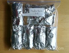 Freezer Cooking Burritos - Place Burritos in Freezer Bag - The Peaceful Mom