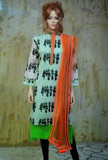 This chanderi silk suit with masaba print and neon coloured dupatta makes a lovely attire for an office day.