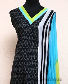 AT033-5 Black colour ikkat printed top with green and blue borders. Blue colour block printed salwar bottom. Blue and green chiffon dupatta.