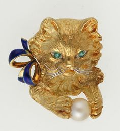 Vintage Gold, Emerald, Pearl and Enamel Cat Brooch, modelled in 18ct yellow gold with textured fur, white gold whiskers and emerald set eyes with blue enamelled bow, holding a cultured pearl ball