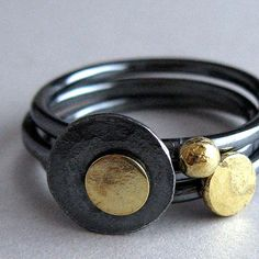 Oxidized sterling silver and 18k gold hand fabricated stacking rings by Quench Metalworks on Flickr