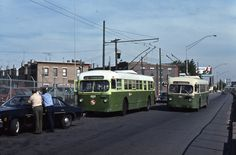 Brill trackless trolley buses 202 and 236 on route 79 in South Philly. Accident aftermath. Photo by Angus. June 1976.
