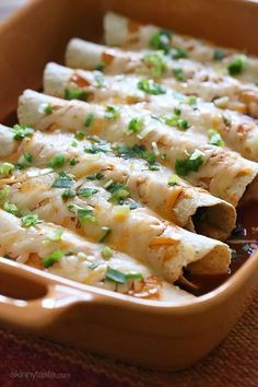 Butternut Squash and Black Bean Enchiladas   Butternut squash, black beans, tomatoes, cilantro and spices are simmered in a skillet with green chilies and jalapeno, then wrapped in tortillas and baked in the oven with enchilada sauce and cheese – these vegetarian enchiladas are delicious and perfect for meatless Mondays, or any day of the week!