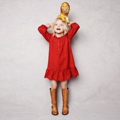 Red dress for Olive. With those boots! Adorable :)