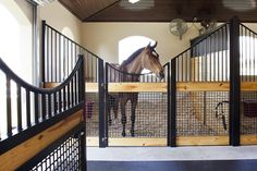 Love the natural beauty of this horse stall. Lucas Equine stalls.