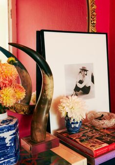 Katie Armour's entry (photo by Cooper Carras, paint: Benjamin Moore Peony, print: Diana Vreeland by Louise Dahl-Wolfe, vases + horn: vintage)