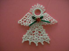 Crocheted Angel  Turn into a pin & can be used too hold glasses in the halo