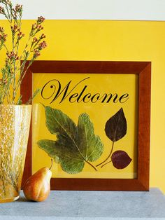 "Framed Fall Welcome        Surround a warm greeting in a basic picture frame. Using a computer, print ""Welcome"" onto a sheet of paper to fit your frame. (You also can handwrite the word or spell it out with letter stickers.) Gently adhere leaves to the paper using double-sided tape. Place the finished greeting in a frame and prop it on an entry table or hang it on the front door to greet guests."