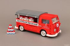 """https://flic.kr/p/Hd79FM   Volkswagen T1 Esso Service   """"canvas"""" pick-up   Put a tiger in your tank!* - Part 1 This VW Type 2 T1 """"canvas"""" pick-up is the LEGO replica of a real T1 registered in 1956 in The Netherlands. It was used by the M.v. Noord, a little company based in Amstelveen (close to Amsterdam) that sold and delivered petroleum for domestic heating. Pieter Grabijn, grandchild of the first owner, found it in a barn few years ago. It was totally rusty. Peter restored the red pick..."""