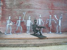 Group picture of tiny robot army!  Created by J.R. Hamm Made of recycled scrap metal