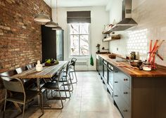Notice the juxtaposition of the red exposed brick on one wall and the white subway tile on the opposite wall.
