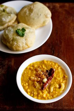 cholar dal - a festive dal that is often made for celebrations in bengal and this includes the durga pooja celebrations. cholar dal is served with luchi or kachori