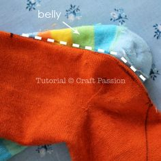 Free pattern & tutorial to sew sock dragon with 2 pairs of socks. This sock dragon has small arms, big foot, a pair of bat wings & a spiky back. – Page 2 of 2