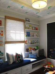 Built in window seat with book shelves