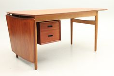 Desk with drawer section in teak. Sliding top. Designed by Arne Vodder in the 1950s and manufactured by Sibast Furniture, Denmark. www.reModern.dk