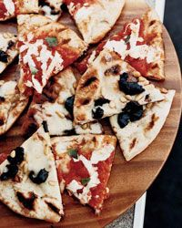 Grilled Margherita and Olive-Fontina Pizzas Recipe on Food & Wine